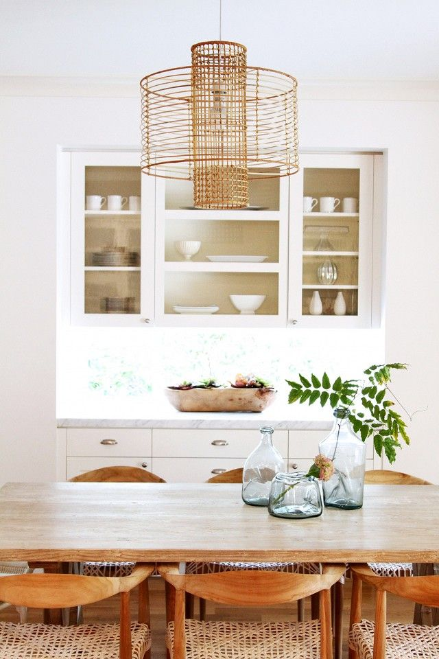 white and wood with natural textures in dining room