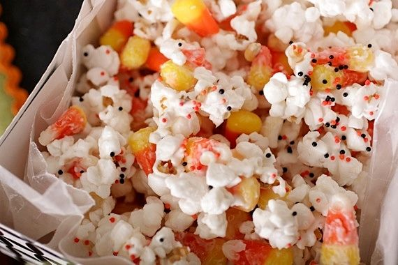 Halloween Popcorn - put two bags of popped popcorn and a bag of candy corn in a bowl,  drizzle 1 package (16 ounces) of white almond bark over the popcorn and candy corn, then spread out on to wax paper. Sprinkle with halloween sprinkles and let cool 15-30 minutes. Then break it up and enjoy!!