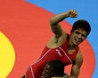 BEIJING - AUGUST 19: Henry Cejudo of the United States celebrates after defeating Shingo Matsumoto of Japan to win the gold medal in the men's 55kg freestyle wrestling event at the China Agriculture University Gymnasium on Day 11 of the Beijing 2008 Olympic Games on August 19, 2008 in Beijing, China.
