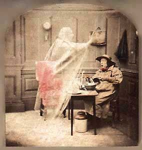 """""""Ghost in the stereoscope"""", published in the late 1850s by The London Stereoscopic Company, the first firm to mass-market 3-D images.    From an online exhibition of spirit photography"""