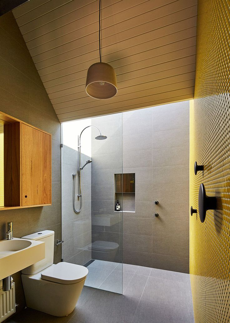 12 Design Ideas For Including Built-In Shelving In Your Shower // This built-in shelf and mirror are a great combo for taking off make up in the shower!