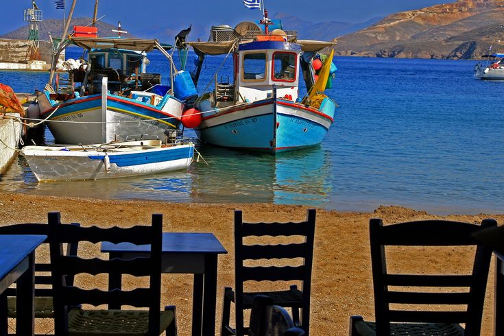 https://flic.kr/p/5c6fFL | Chairs and boats, Leros island | A few wooden chairs in a tavern along the beach and fishing boats, Pandeli harbour, Leros Island, Dodecanese, Greece