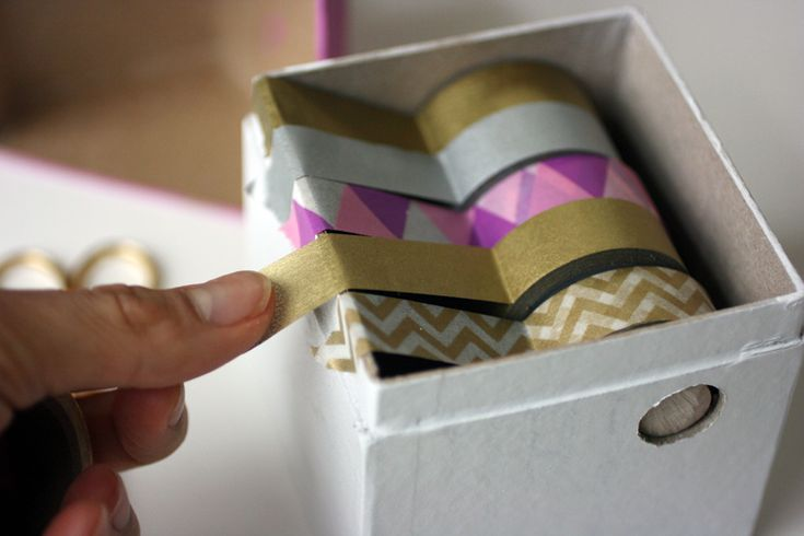 diy washi tape dispenser. Love the use of the metal teeth from a box of tin foil.