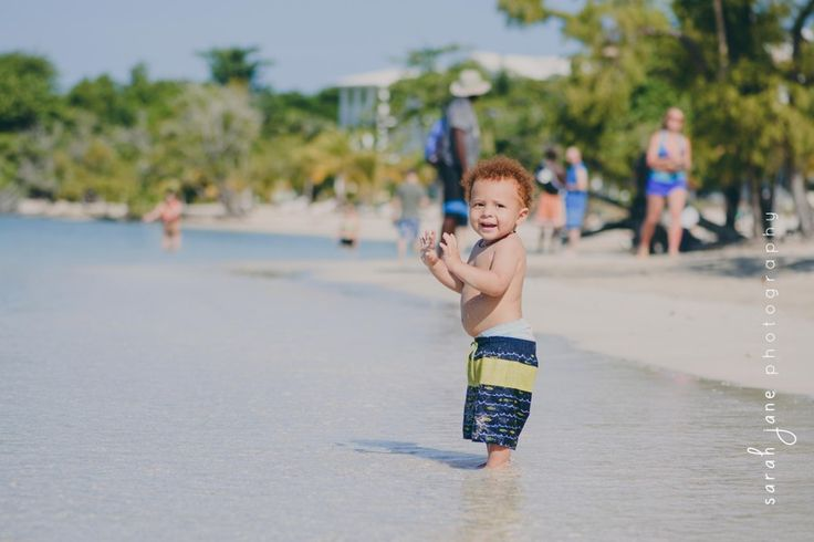 Boy in the water at a beach in Jamaica