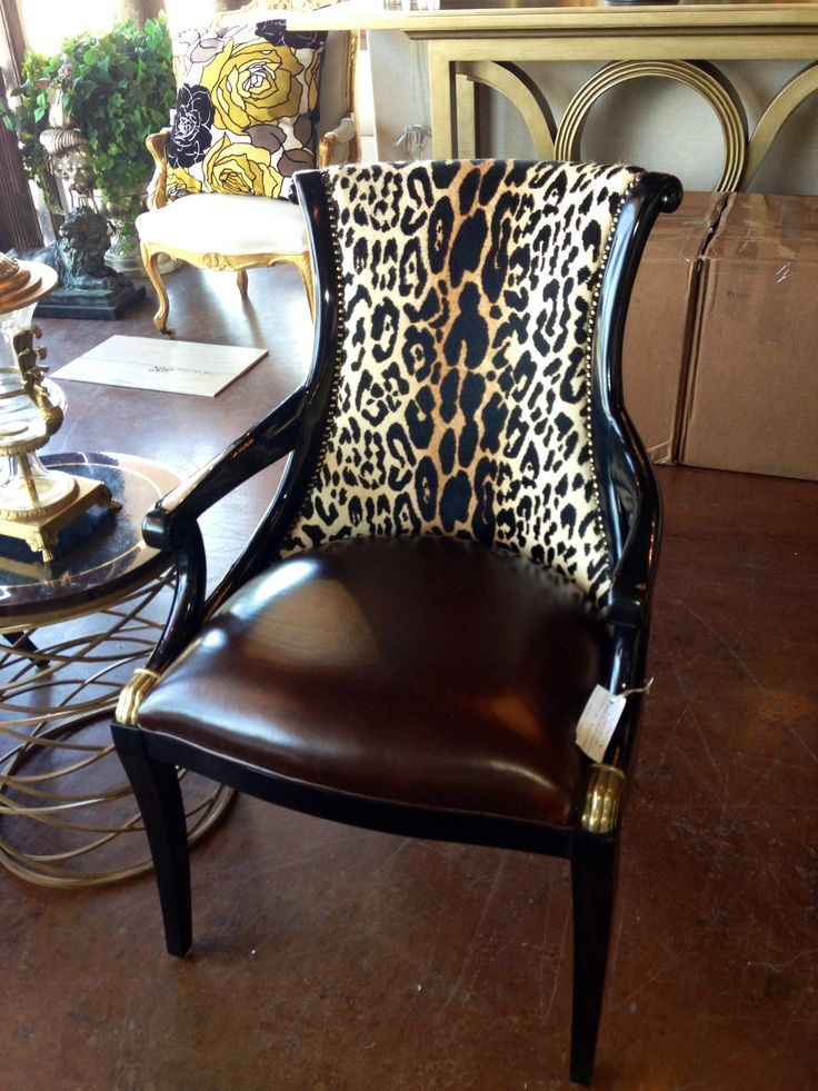 Brittnay Blake Interiors. Houston. Animal print, leather and nailhead trim.