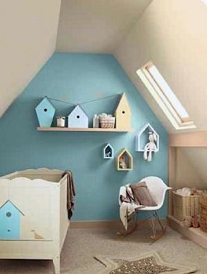 accent wall with birdhouses in small space baby nursery