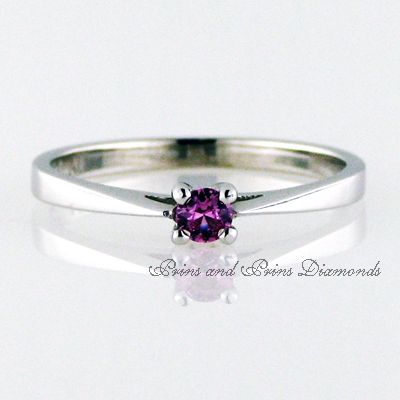 0.13ct Pink sapphire 4 claw set in 18k white gold