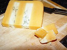 We stock this fairly labor intensive cheese as that is hand layered. The contrasting flavors and textures create a harmonious blend. The cheese is dense yet also creamy. It is salty and sharp but also nutty.