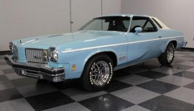 My first car, 1974 Oldsmobile Cutlass Supreme (mine was brown with white top)