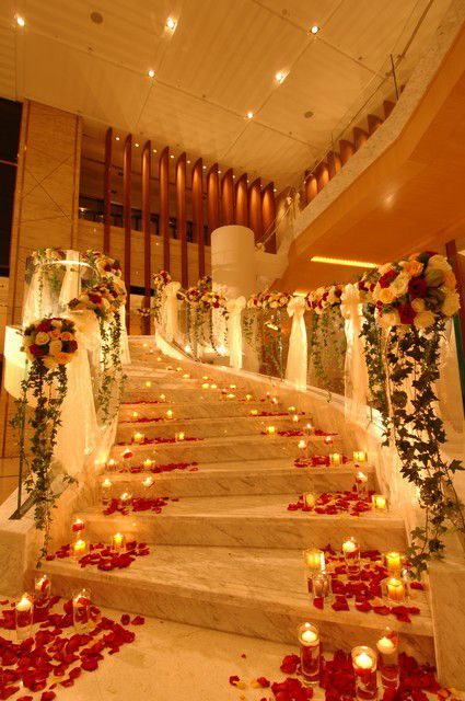 stunning entry/  floral pedals & candles / <3