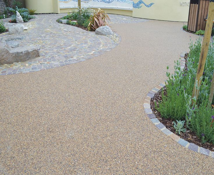 Clearstone Resin Bound Gravel for paths and terrace. Resin bound paving can perfectly complement other paving materials like decorative cobbles.