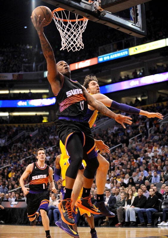 38f95c708426 P.J. Tucker and the Phoenix Suns debuted their black retro jerseys in a win  over the Lakers on Jan. 30