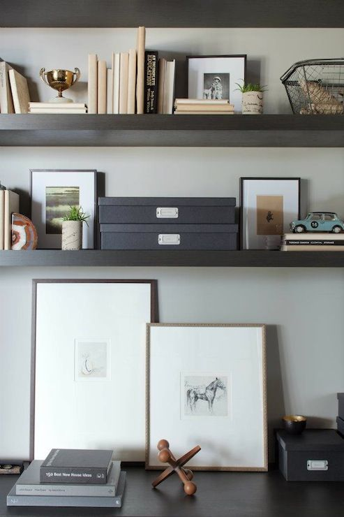 image via Decor Pad | Office vignette with espresso floating shelves, black file boxes and gallery frames.