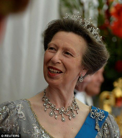 Princess Anne dazzled in diamonds and a glittering grey dress as she waits for the arrival...