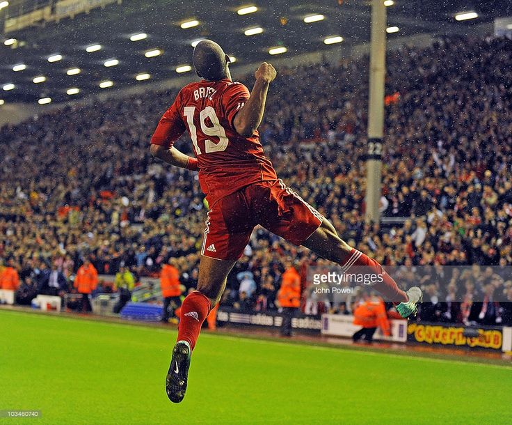 Ryan Babel of Liverpool celebrates scoring the first goal during the UEFA Europa League Play off...