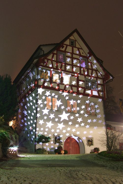 Lights projected on house