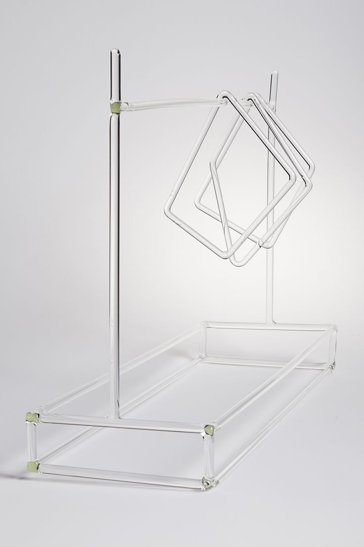 FLAGS designed by Sam Baron - It seems that the freedom of the wind let this three squared pieces of glass hanged on their base structure in a position for ever. Instead you can give a different aspect to the ensemble by moving them as you feel, creating each time a new landscape.  #drawingglass #fabricadesignstudio #fabrica #design #glass #sambaron #massimolunardon