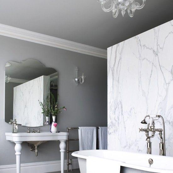 Vintage feminine style bathroom with white marble wall  Image: Mel Yates