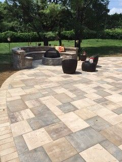 This beautiful New Jersey outdoor living space was created by Artistic Pavers using the following products by Cambridge Pavingstones with Armortec:  Patio Pavingstones: The Sherwood Collection, Ledgestone XL 3. Pc. Design Kit in Toffee Onyx Lite, Sahara Chestnut Lite, and Sandstone  Patio Border: The Sherwood Collection, 4.5 x 9 in Sandstone  Landscape Wall: Olde English Wall in Toffee Onyx Lite  Fire Pit Kit: Olde English Fire Pit Kit in Toffee Onyx Lite