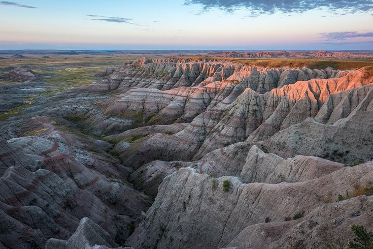 Photo by @michaelclarkphoto // Panorama Point in Badlands National Park near Wall, South Dakota. The Badlands are pretty striking. It is a landscape photographers dream National Park in many ways. There are no waterfalls (at least that I saw) but instead there are deep canyons with striped layers and fantastic light. #badlands #badlandsnationalpark #southdakota