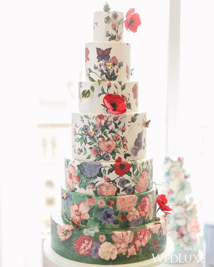 Can you spot the real blooms against the convincing hand-painted floral pattern? | Photography By: Artiese Studios. | WedLuxe Magazine | #wedding#luxury #weddinginspiration #luxurywedding #floral #cake #weddingcake #dessert #sweets