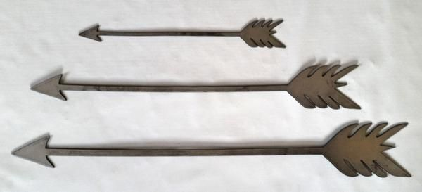 """Steel arrows available in 3 sizes, unfinished. Unfinished; raw, are pulled directly off the CNC Plasma Cutter and shipped to you. Measurements: - Small 1 7/8"""" by 14"""" - Medium 3"""" by 22"""" - Large 3 5/8"""""""