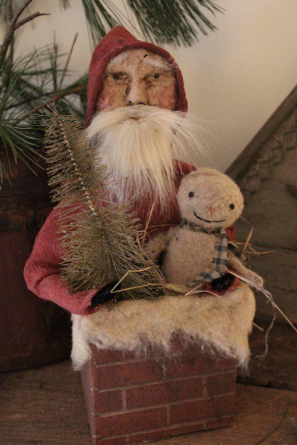 Santa and snowman. Folk art