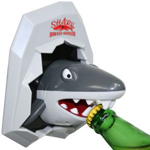 Wall Mount bottle opener with a shark out of ice.