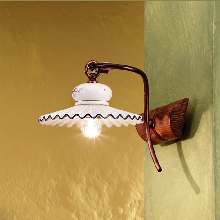 Elegant wall lamp with wood support, and entirely hand decorated ceramic shade.