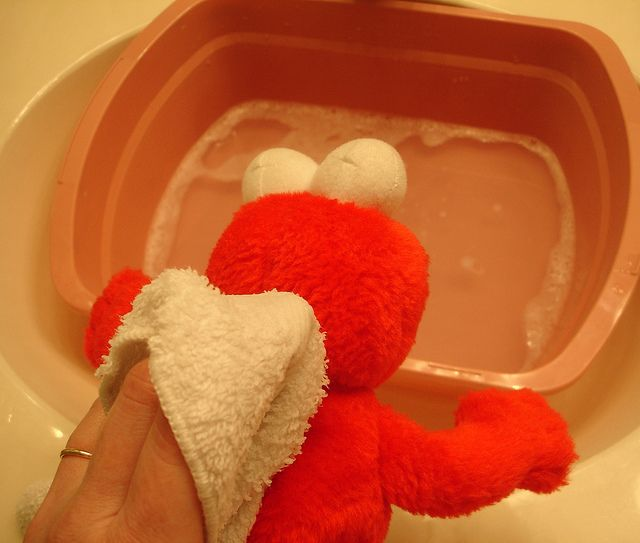 Wash stuffed-animals: One tablespoon HE laundry detergent + two wash clothes + big basin: Dilute detergent with enough water, dip wash cloth in it and wipe the stuffed-animal clean. Use a toothbrush to get stains off. Once you are done cleaning, dip the other wash cloth in cold water and wipe the stuffed-animal 2-3 times very well until soap and dirt come off completely.