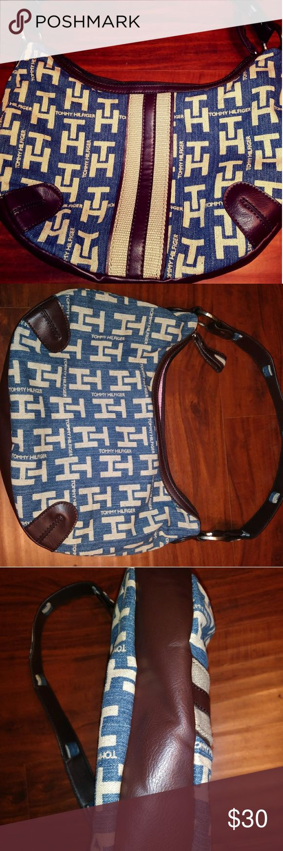 Vtg Tommy Hilfiger Blue White Purse Handbag You'll love this Tommy handbag.  It features a blue and white logo pattern with brown leather accents.  The interior is lined with pink.  This is perfect for any Tommy Fan!  Bag Height:  8.5 Bag depth:  7.5 Bag Length:  12  *Box 7 Tommy Hilfiger Bags Shoulder Bags