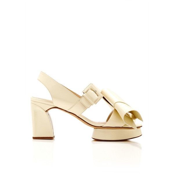 This open toe slingback DELPOZO sandal features exaggerated bow detail at  the toe strap, a covered island platform and a covered sculpted block