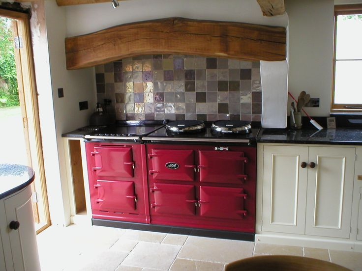 An Aga cooker in my kitchen.  I first heard about these years ago in some English novel.  Along with a scrubbed pine table and a farmer's sink.  What a beauty this is!