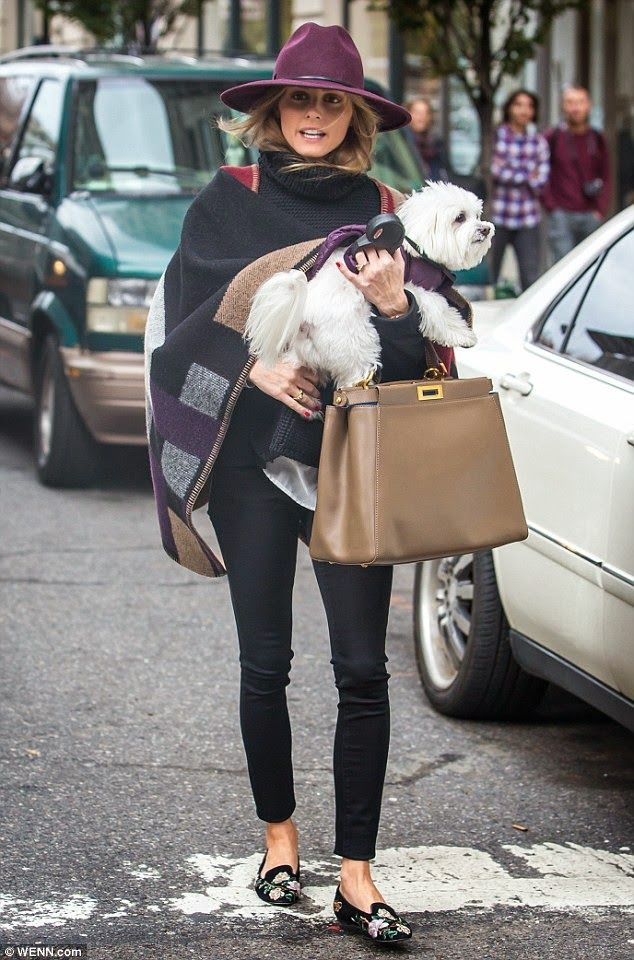 The Olivia Palermo Lookbook : Olivia Palermo in New York. Buberry cape, flat shoes, jeans and a hat in burgundy.