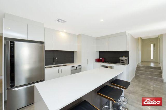 Kitchen - I like the dark splashbacks and white gloss cabinets