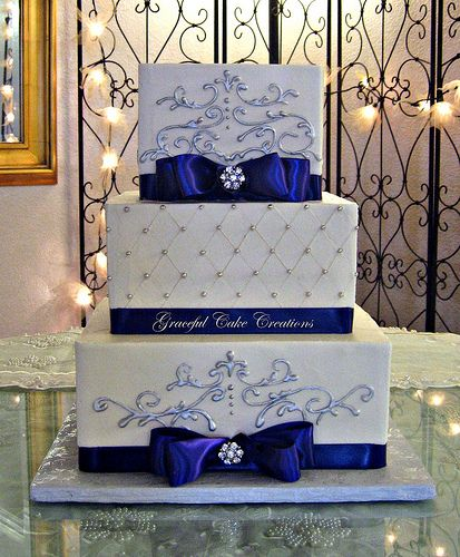 Elegant Square Wedding Cake with Purple Ribbon and Silver Scrolls
