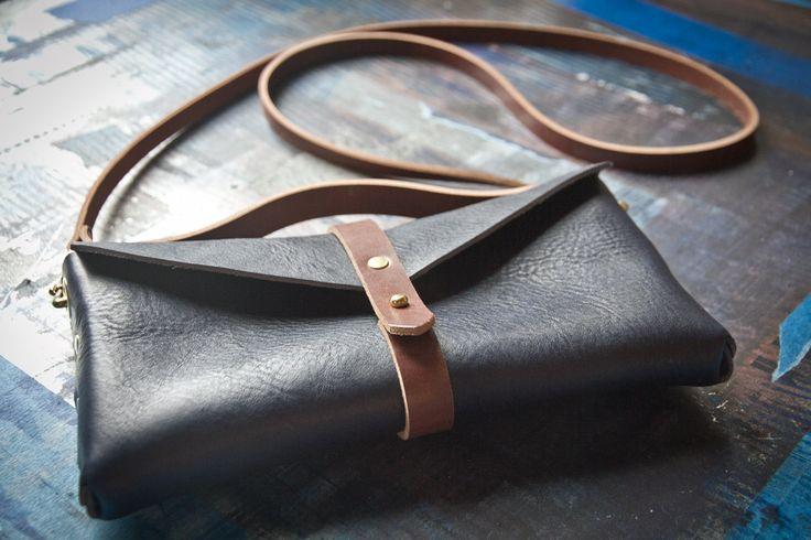 Handmade leather clutch bag in navy