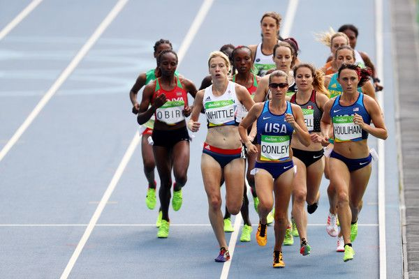 Laura Whittle of Great Britain, Kim Conley of the United States, and Shelby Houlihan of the United States lead the pack during the Women's 5000m Round 1 - Heat 1 on Day 11 of the Rio 2016 Olympic Games at the Olympic Stadium on August 16, 2016 in Rio de Janeiro, Brazil.