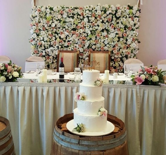 We are loving the floral wall that served as a romantic backdrop to the Bride and Groom as they wined, dined and danced the night away.
