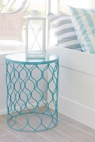 Spray paint a metal trash can and flip over for an instant side table.  I really want to pin this so I will remember it... So if we are pinterest friends, act like you dont see it so you wont know I have upside down trash cans all over my house