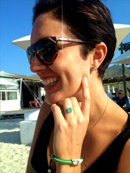 Socialite Jackie Wiese wearing her green URU Bangle with her green diamond