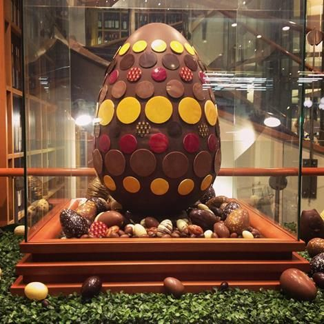 A garden hosting a giant Easter egg in our shop window