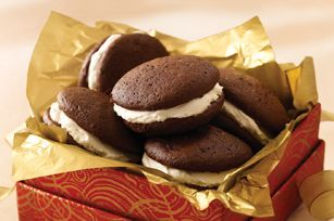 "Triple-Chocolate Whoopie Pies recipe -- By far my favorite whoopie pie. It's way easy. This recipe calls for a box of a box of pudding mix which gives the ""pie"" part the most perfect texture. I am making them for my wonderful, super-hero of a dad for Fathers day!!"