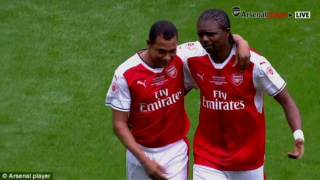 But Gilberto Silva escorted Nwankwo Kanu off the pitch before the start of the game