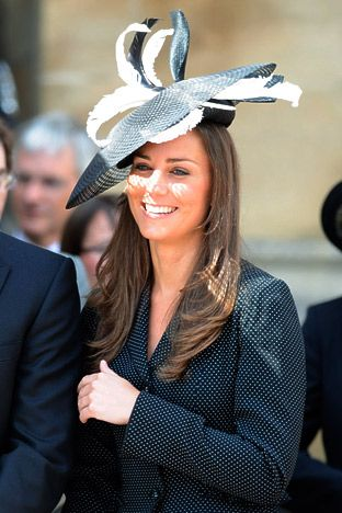 Flirting with Feathers Middleton looked on in a tailored suit and a Philip Treacy topper during Prince Williams Order of the Garter procession where he was installed by Queen Elizabeth as a knight.