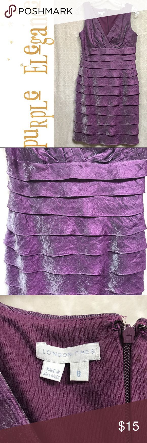 London Times a Pretty Purple Silklike Dress This dress is definitely not your stay at home kind of dress. It wants to go out on the town! It has a bit of a sheen reminiscent of a silk organza. It's a beautiful shade of purple. This dress has a very flattering V-neck design and measures 35 inches in circumference just beneath the armpit and 36 inches in length. Please note there are some water spots on the lining on the inside back near the zipper. The outside of the dress is excellent with…