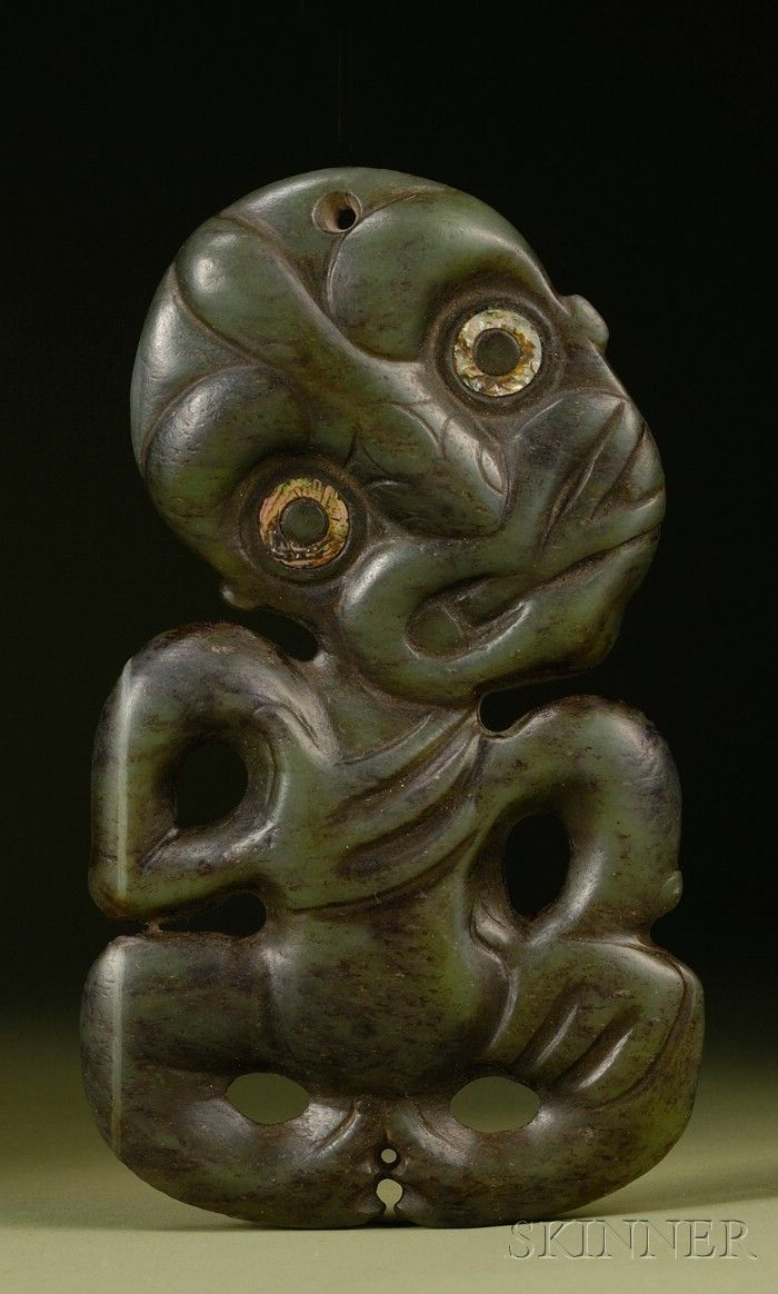 Polynesian Carved Greenstone Neck Pendant, Hei Tiki, Maori, New Zealand, 19th century, carved with oval shaped head, chin toward the left shoulder, right hand to the chest, left hand to the thigh, with haliotis shell ringlets around the pupils, pierced at top and bottom for suspension, ht. 6, wd. 3 1/2 in.
