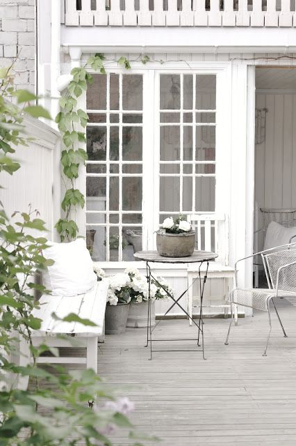 Pretty porch with awesome doors - via Vintage Interior