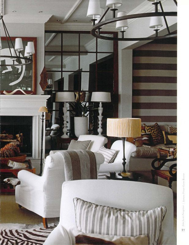 The mullioned mirrored walls flanking the fireplace, the tones and textures  are amazing in this room.