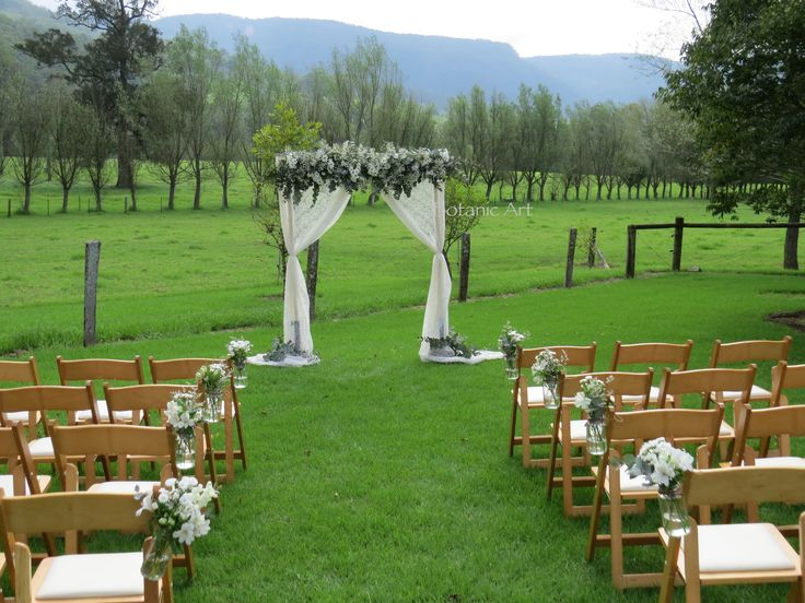 ceremony arch, pew flowers, country, vintage, baby's breath, daisies, blue gum, Melross, Kangaroo Valley